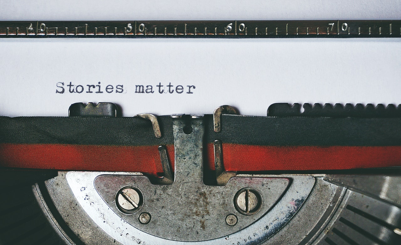 Typewriter typing the phrase stories matter