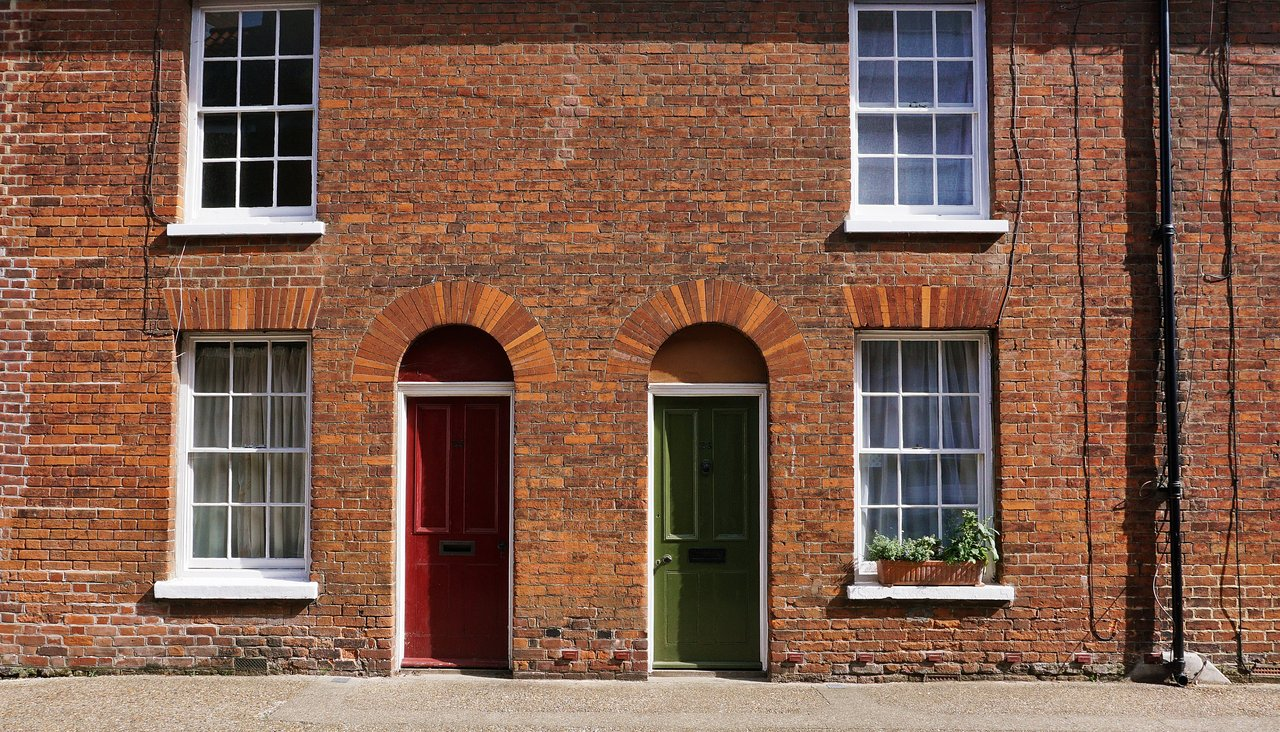 Brick houses with red and green front doors