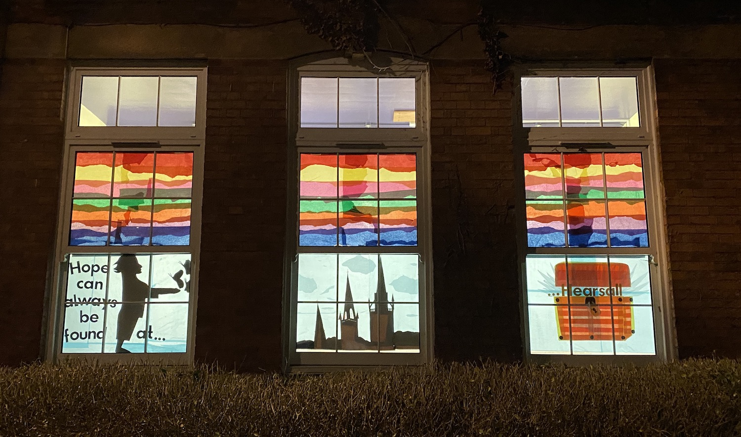 A local primary school offers a message of hope with this rainbow window depicting a child and a book.